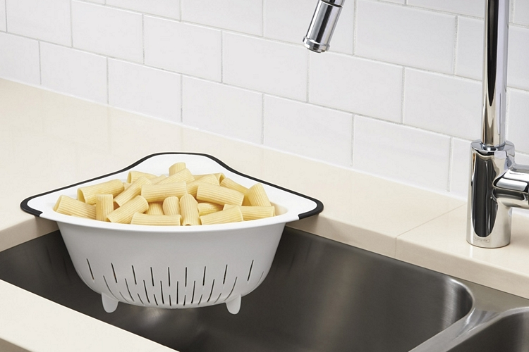 OXO's Over-the-Corner Colander Latches On To A Sink Corner